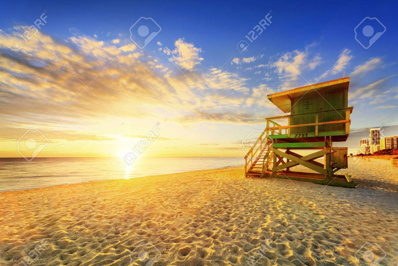 Miami South Beach sunrise with lifeguard tower and coastline with colorful cloud and blue sky. - 39267521