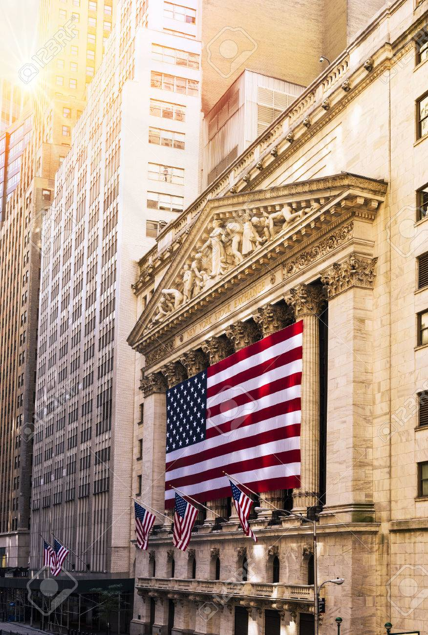 Famous Wall street and the building in New York, New York Stock Exchange with patriot flag - 44771958