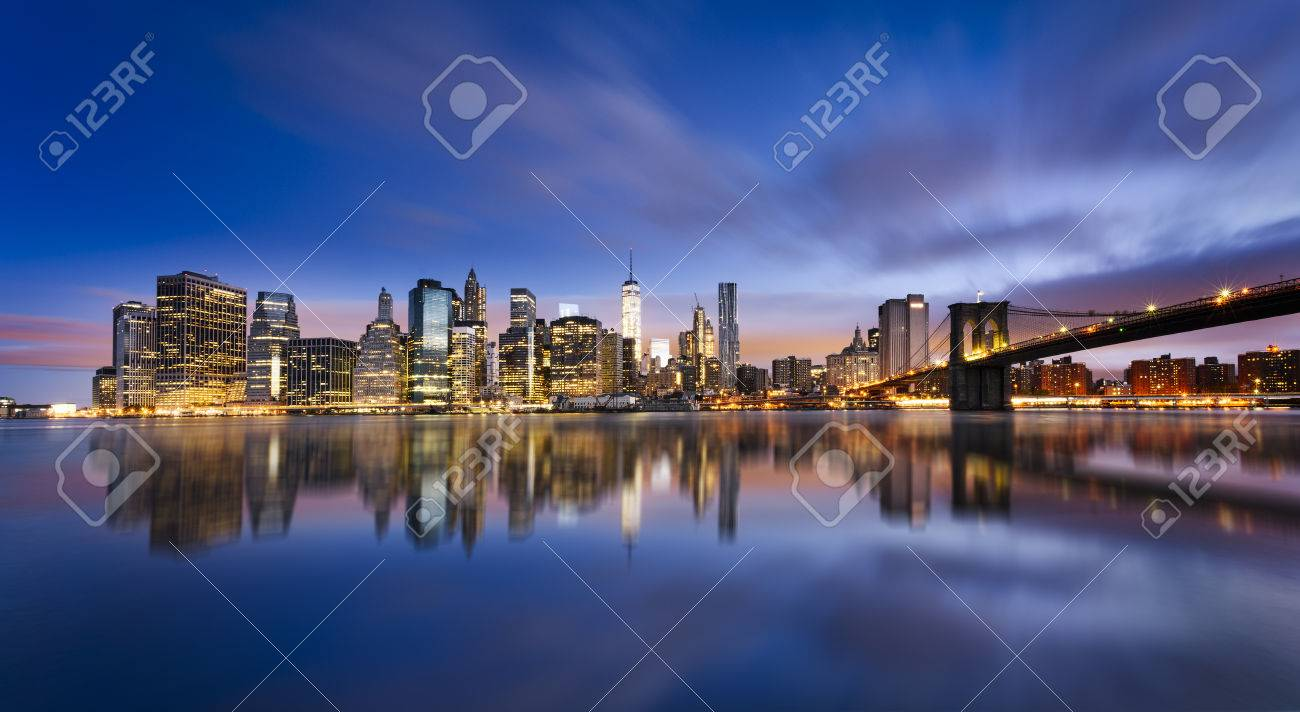 New York City - beautiful sunrise over manhattan with manhattan and brooklyn bridge USA - 46577284