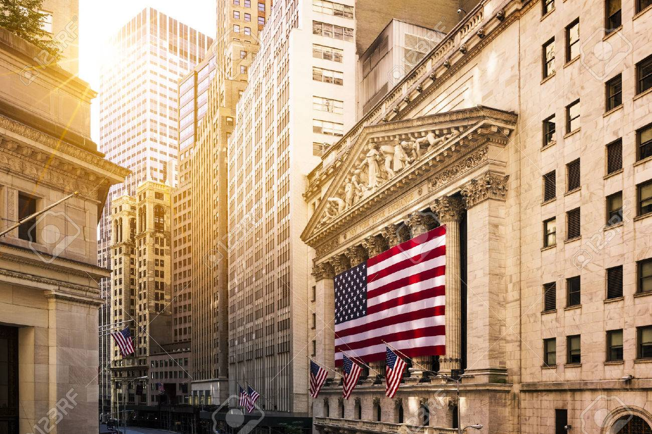 Famous Wall street and the building in New York, New York Stock Exchange with patriot flag - 56004246