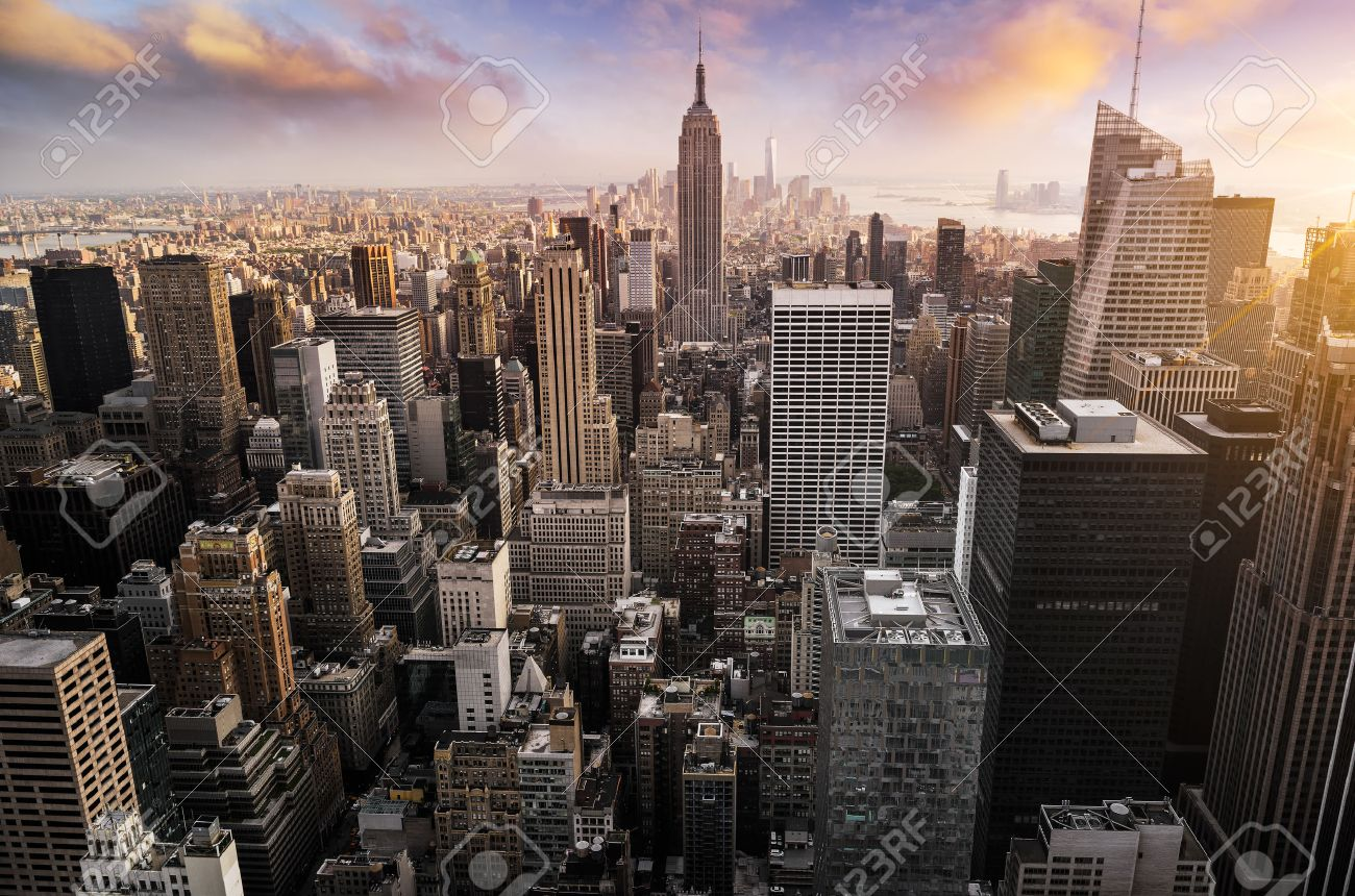 New York City skyline with urban skyscrapers at sunset, USA. - 56795824