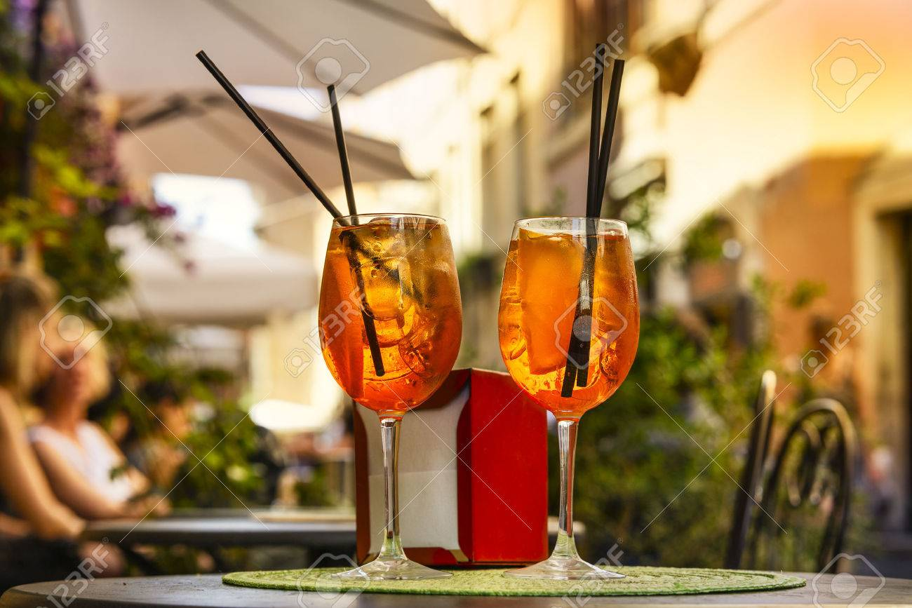 Aperol Spritz Cocktail. Alcoholic beverage based on table with ice cubes and oranges. - 65111043