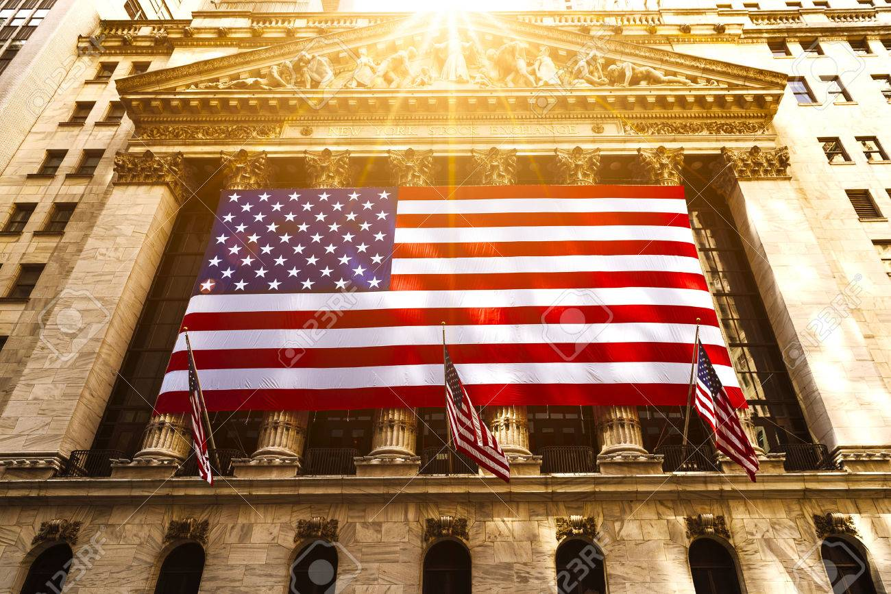 Famous Wall street and the building in New York, New York Stock Exchange with patriot flag - 67414030