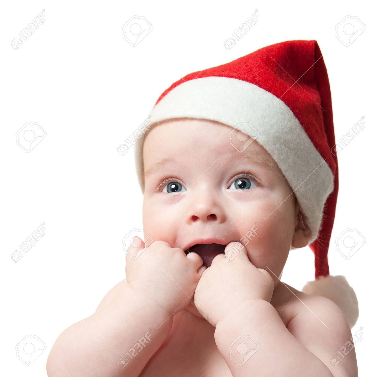 f1b99d96c Portrait of cute baby boy in Christmas hat, isolated on white..