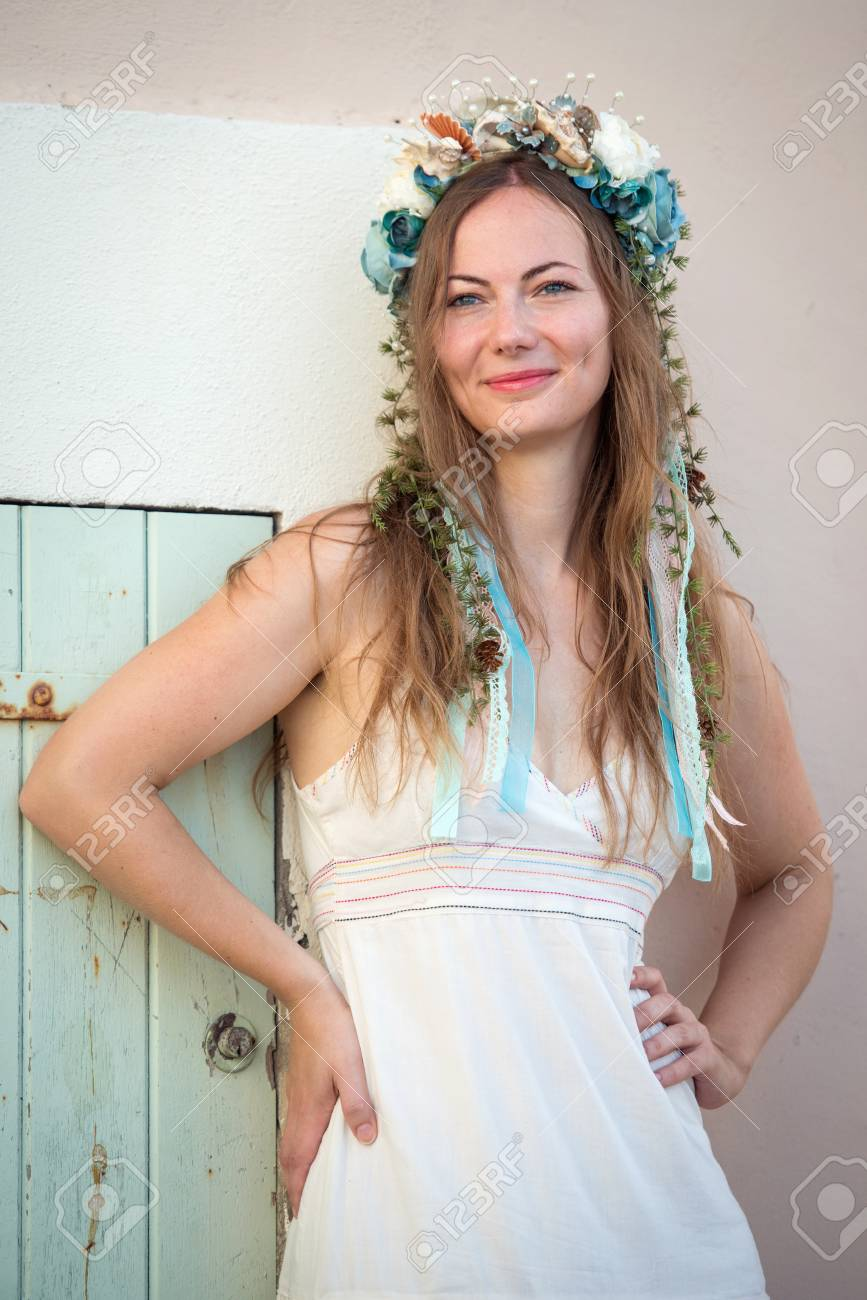 Detail of young woman in white dress with flower head band standing detail of young woman in white dress with flower head band standing by the door stock mightylinksfo
