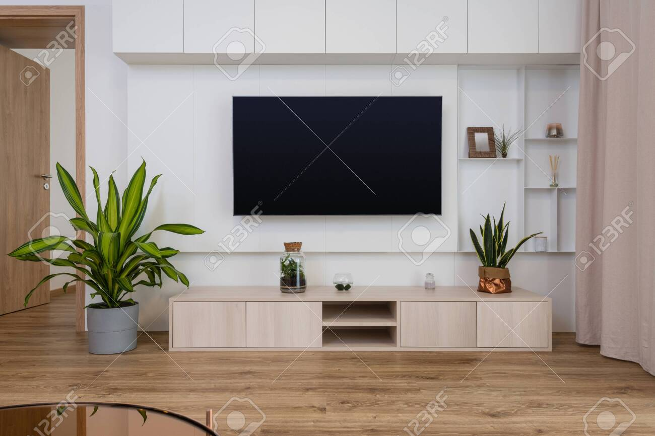 Interior Of Contemporary Living Room With Tv On The Wall Stock Photo Picture And Royalty Free Image Image 132309321