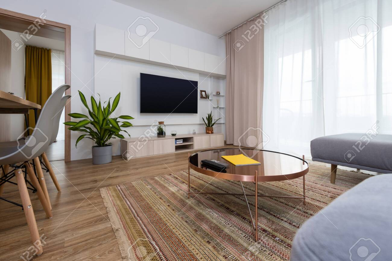 Interior Of Contemporary Living Room With Tv On The Wall Stock Photo Picture And Royalty Free Image Image 132308848