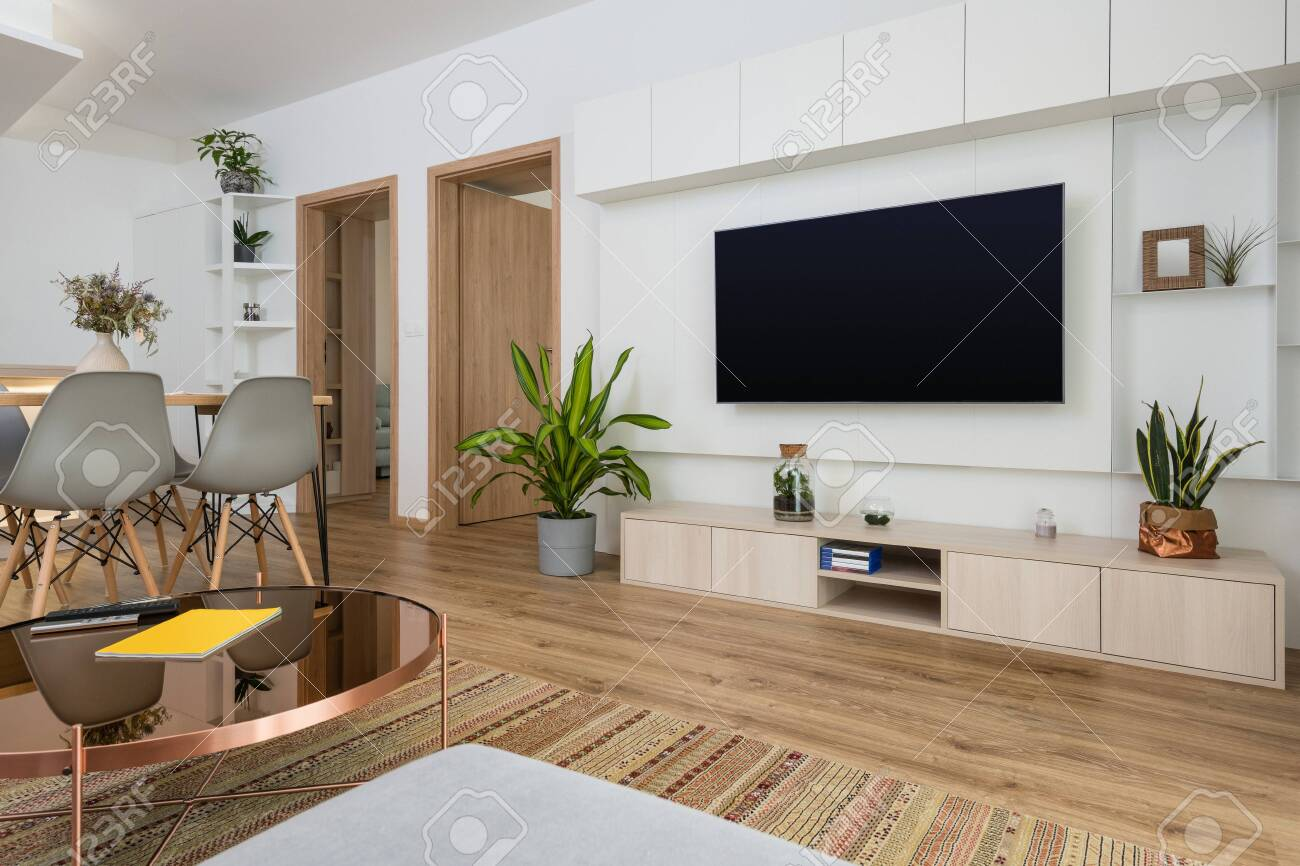 Interior Of Contemporary Living Room With Tv On The Wall Stock Photo Picture And Royalty Free Image Image 132309182