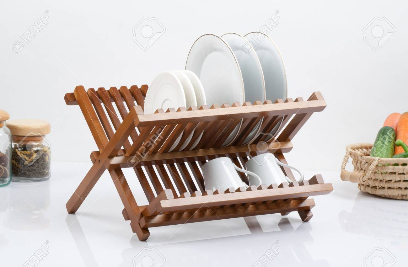 A Small Wooden Shelf For Keeping Dishes And Cups