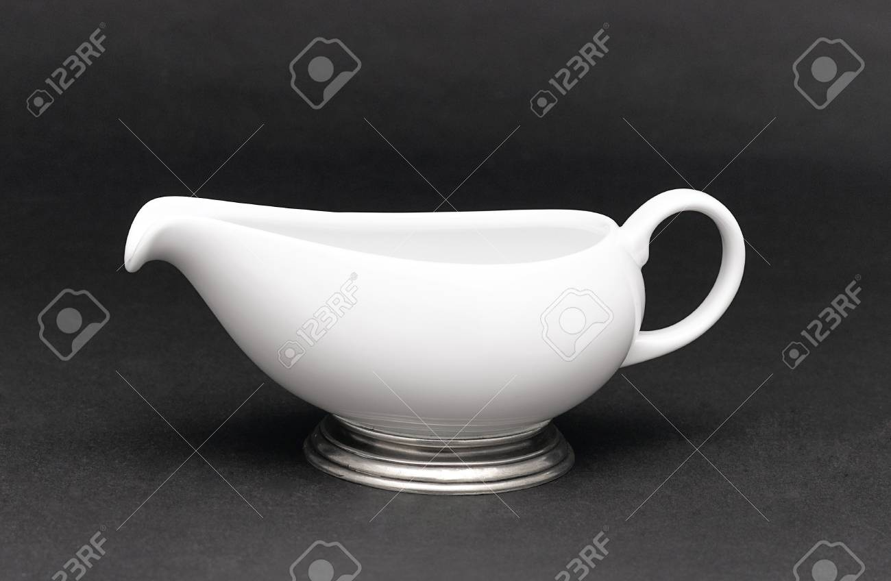 A porcelain pitcher for milk , tea or coffee decorated by pewter Stock Photo - 17433567