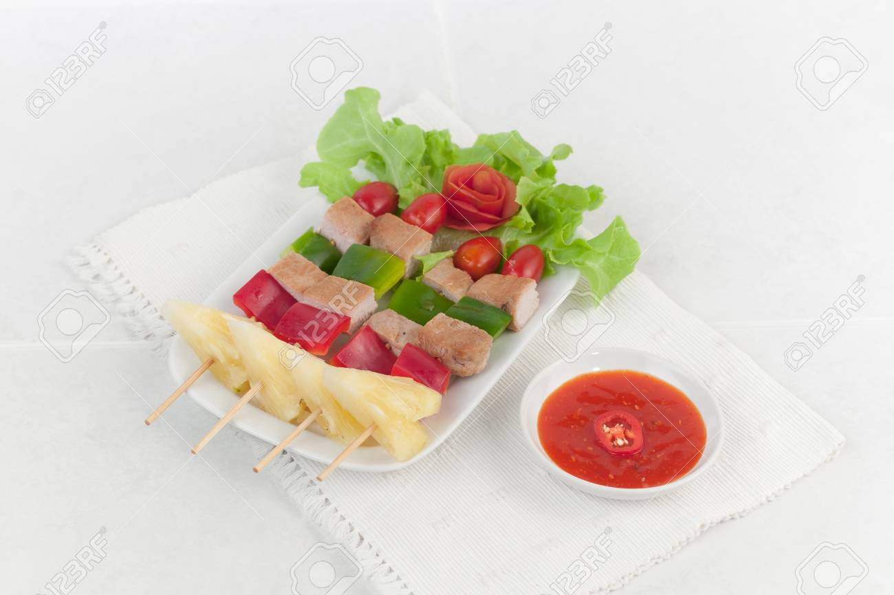 Pork and vegetables on barbecue skewers served on a white dish Stock Photo - 18117256