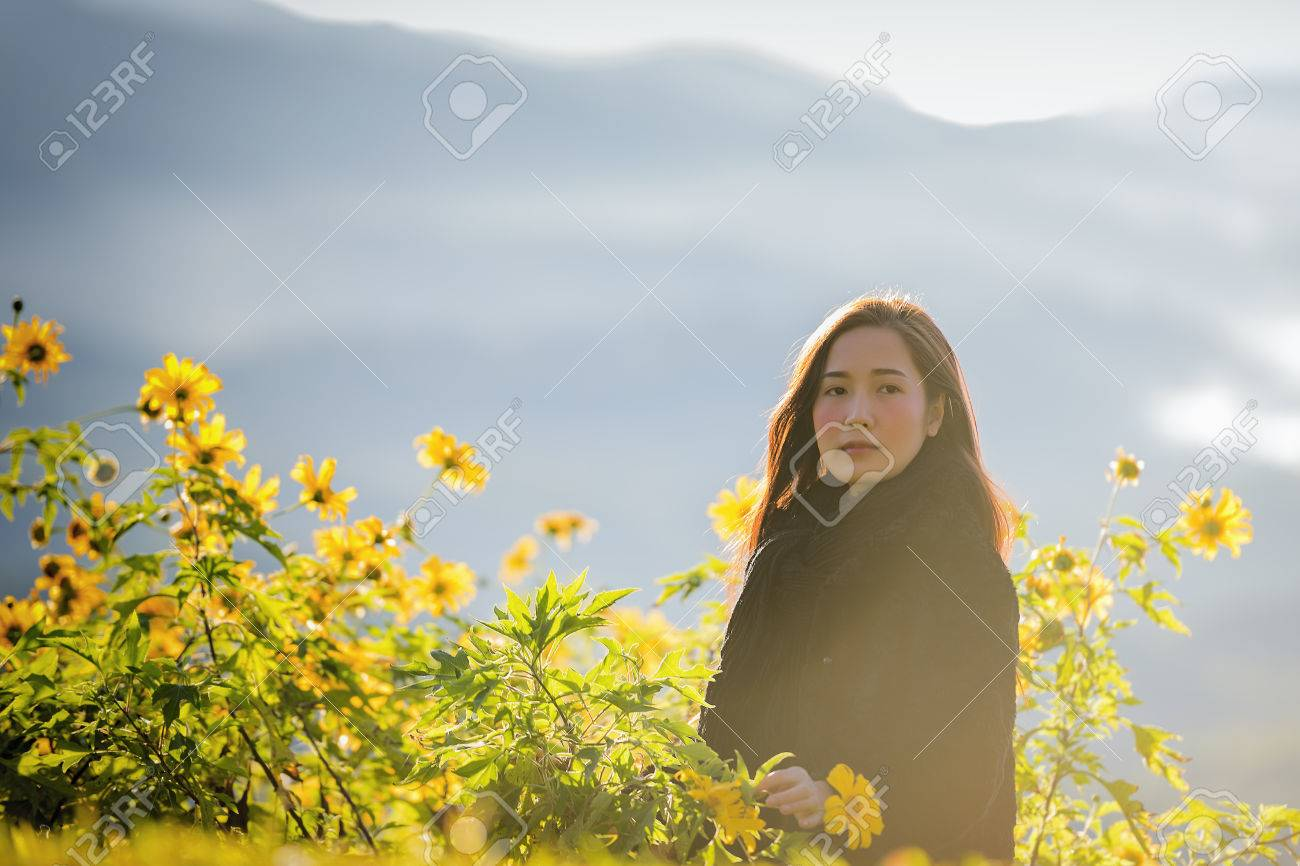 Beautiful girl with flower and fog on the mountainview of mountains beautiful girl with flower and fog on the mountainview of mountains winter landscape izmirmasajfo