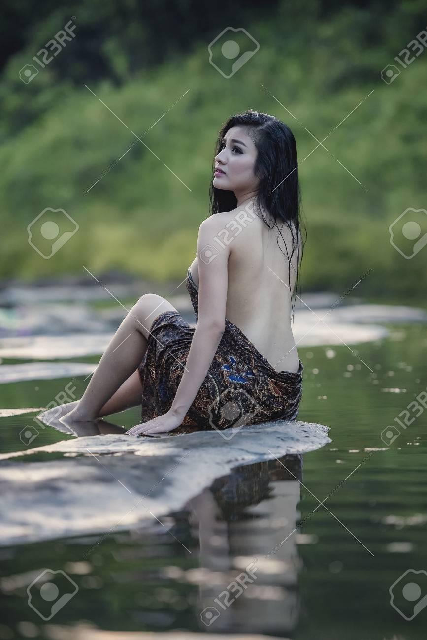 Asian woman bathing