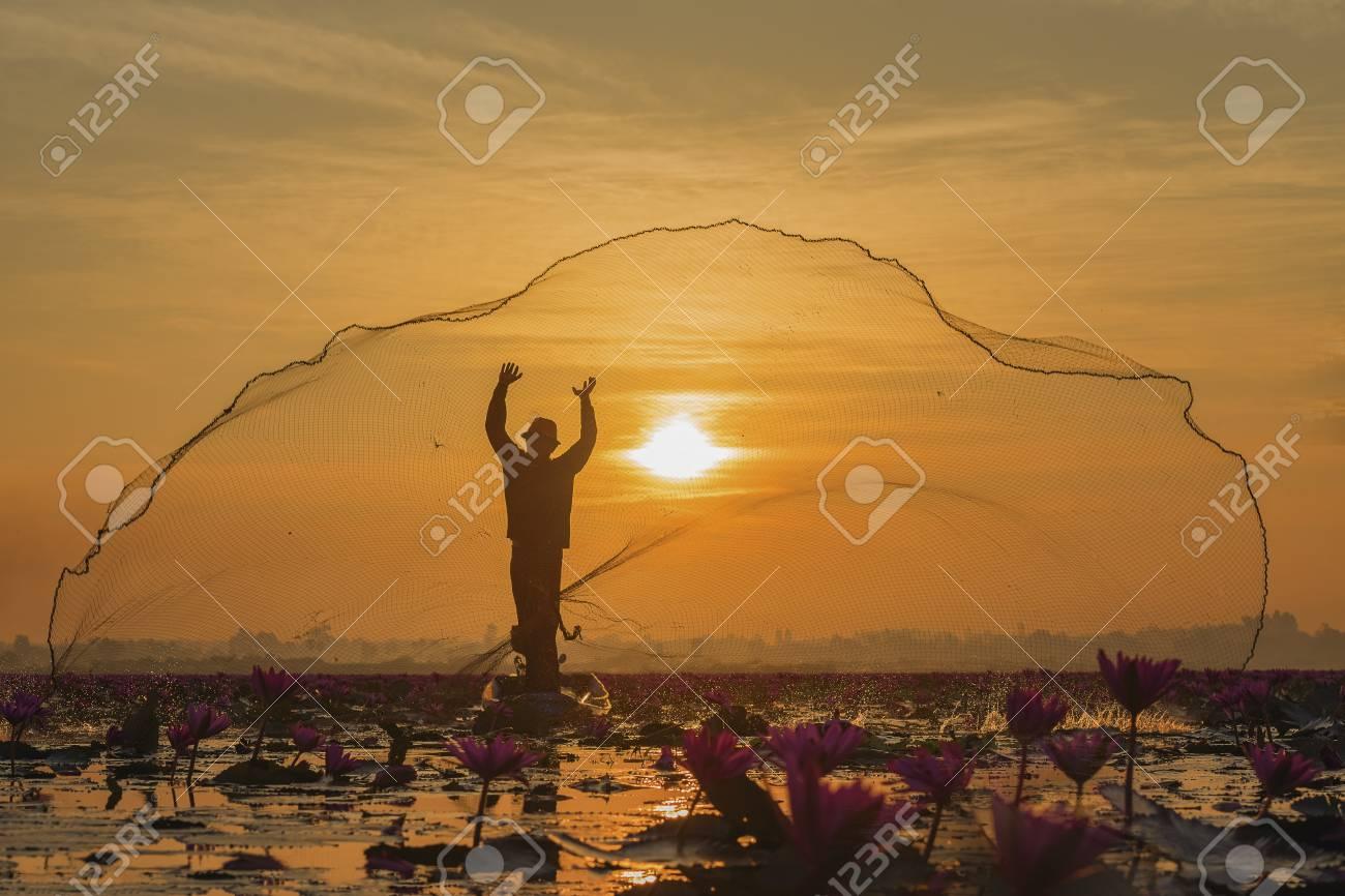 Fishermen fishing in the early morning golden light,fisherman