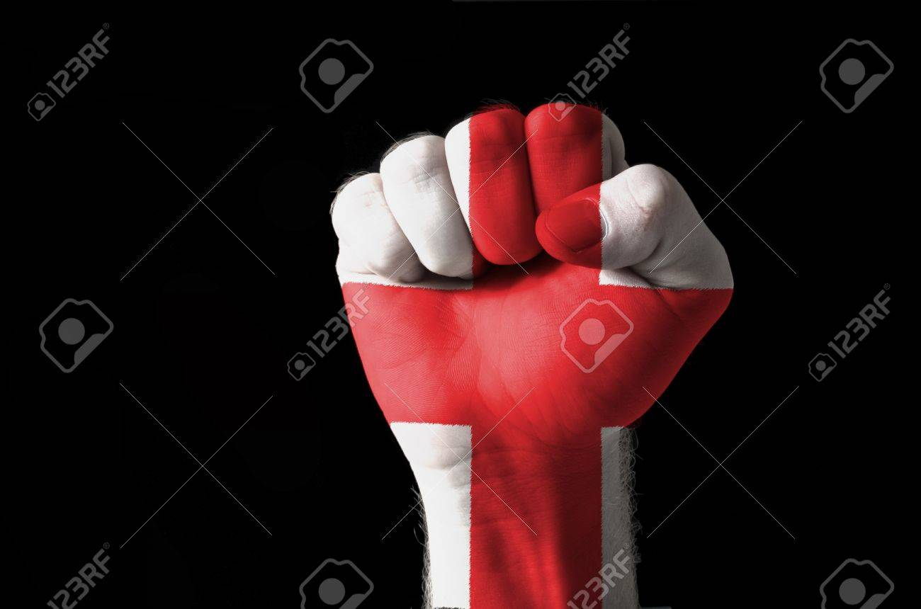 Low key picture of a fist painted in colors of england flag Stock Photo - 11063269
