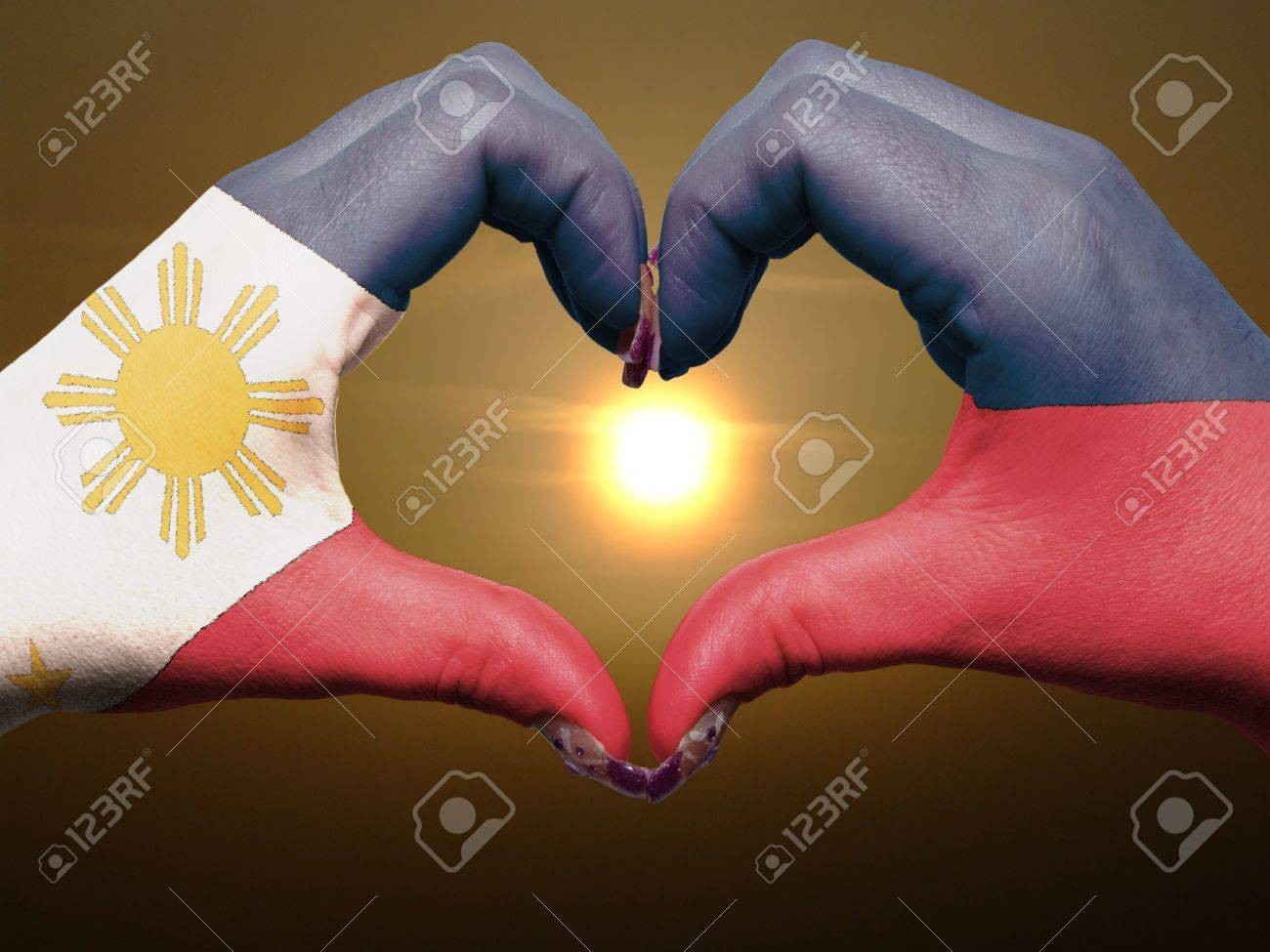 Tourist made gesture by philippines flag colored hands showing tourist made gesture by philippines flag colored hands showing symbol of heart and love during sunrise buycottarizona Images