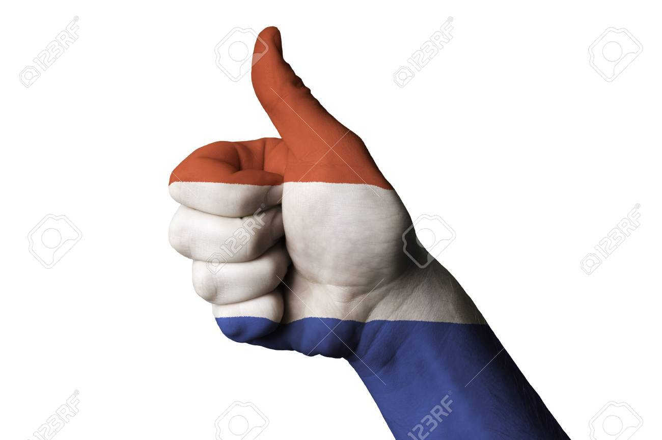 Hand with thumb up gesture in colored netherlands national flag as symbol of excellence, achievement, good, - useful for tourism and touristic advertising and also current positive political, cultural, social management of state or country Stock Photo - 12982096