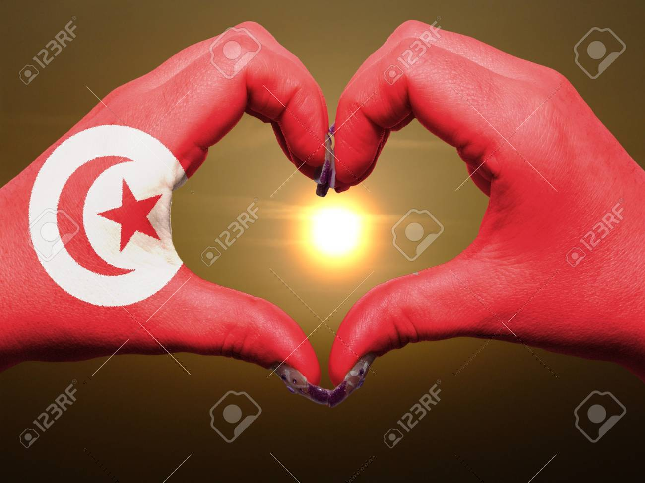 Tourist made gesture  by tunisia flag colored hands showing symbol of heart and love during sunrise Stock Photo - 13564023