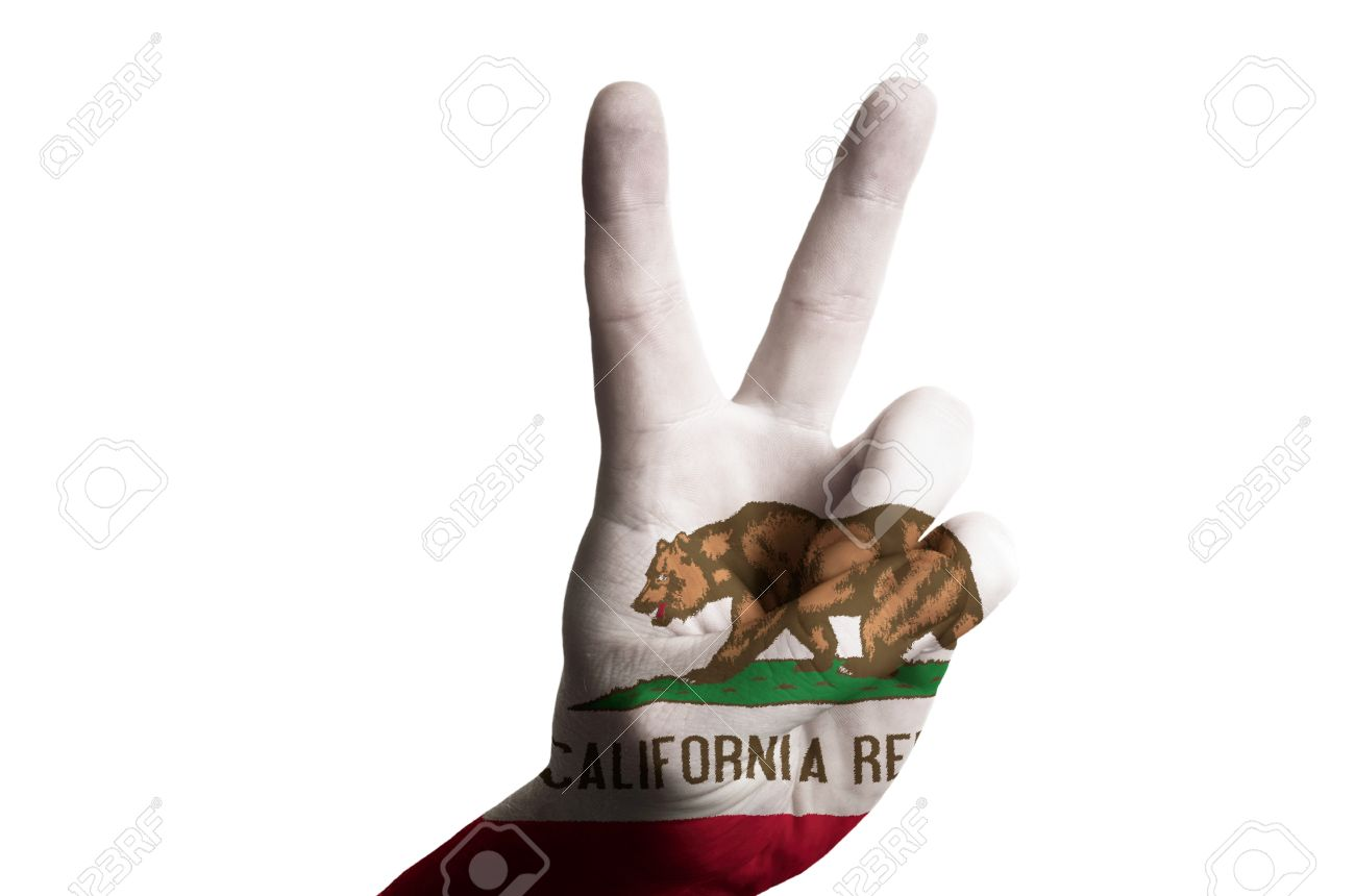 Hand with two finger up gesture in colored california state flag hand with two finger up gesture in colored california state flag as symbol of winning buycottarizona