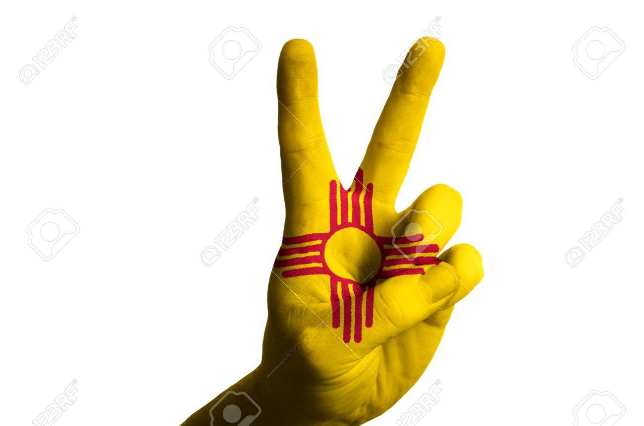 Hand with two finger up gesture in colored new mexico state flag hand with two finger up gesture in colored new mexico state flag as symbol of winning buycottarizona