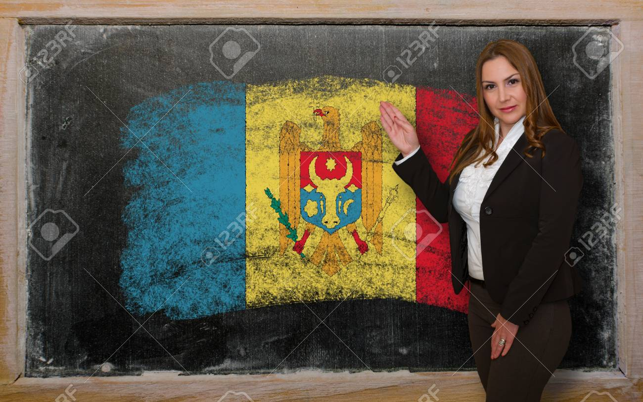 Successful, beautiful and confident woman showing flag of Moldova on blackboard for marketing research, presentation and tourist advertising Stock Photo - 18632365