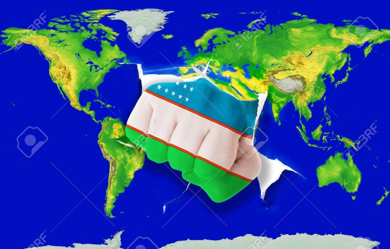 Fist in color national flag of uzbekistan punching world map stock fist in color national flag of uzbekistan punching world map as symbol of export economic gumiabroncs Images