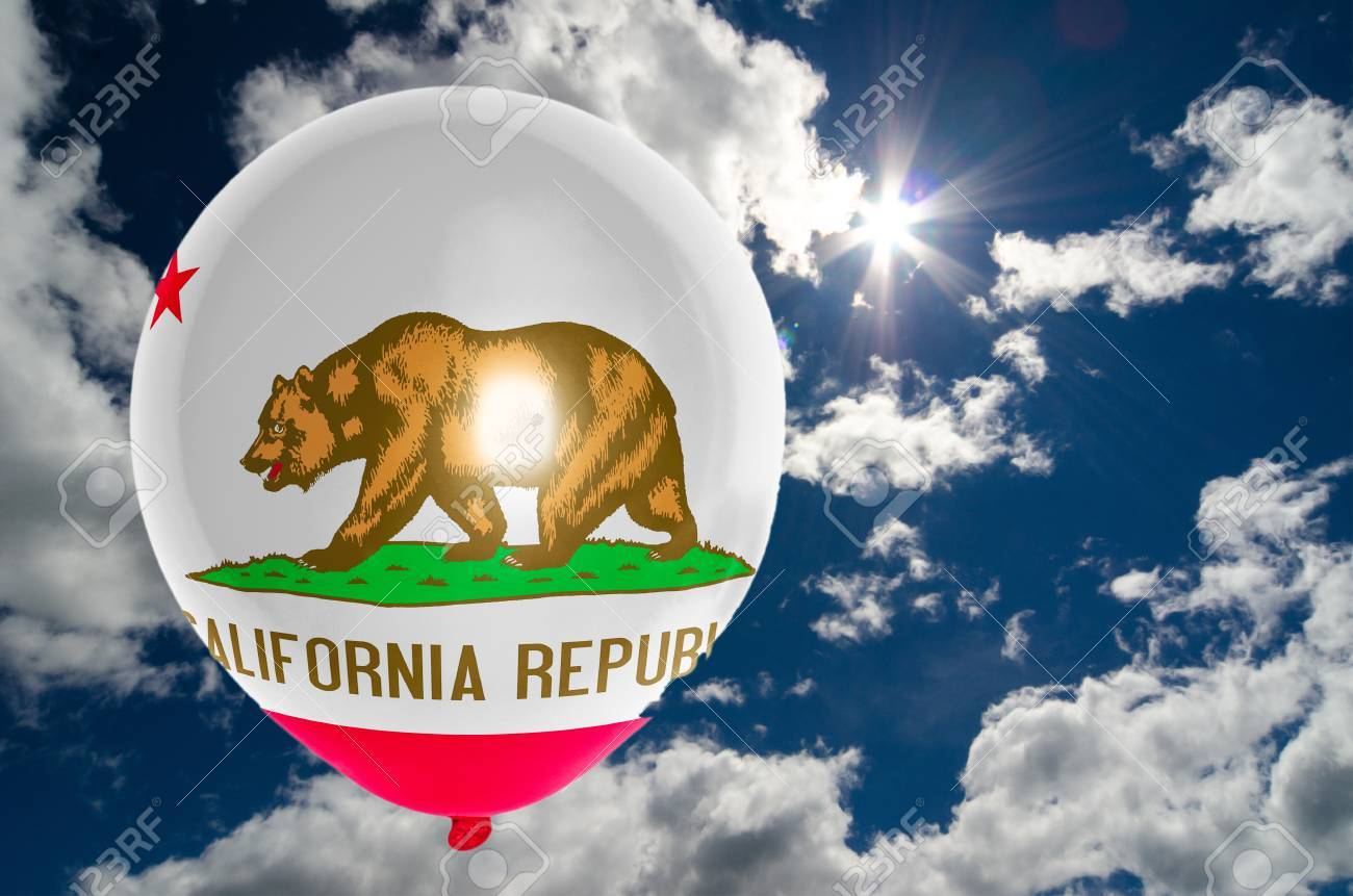 balloon in colors of california flag flying on blue sky stock photo