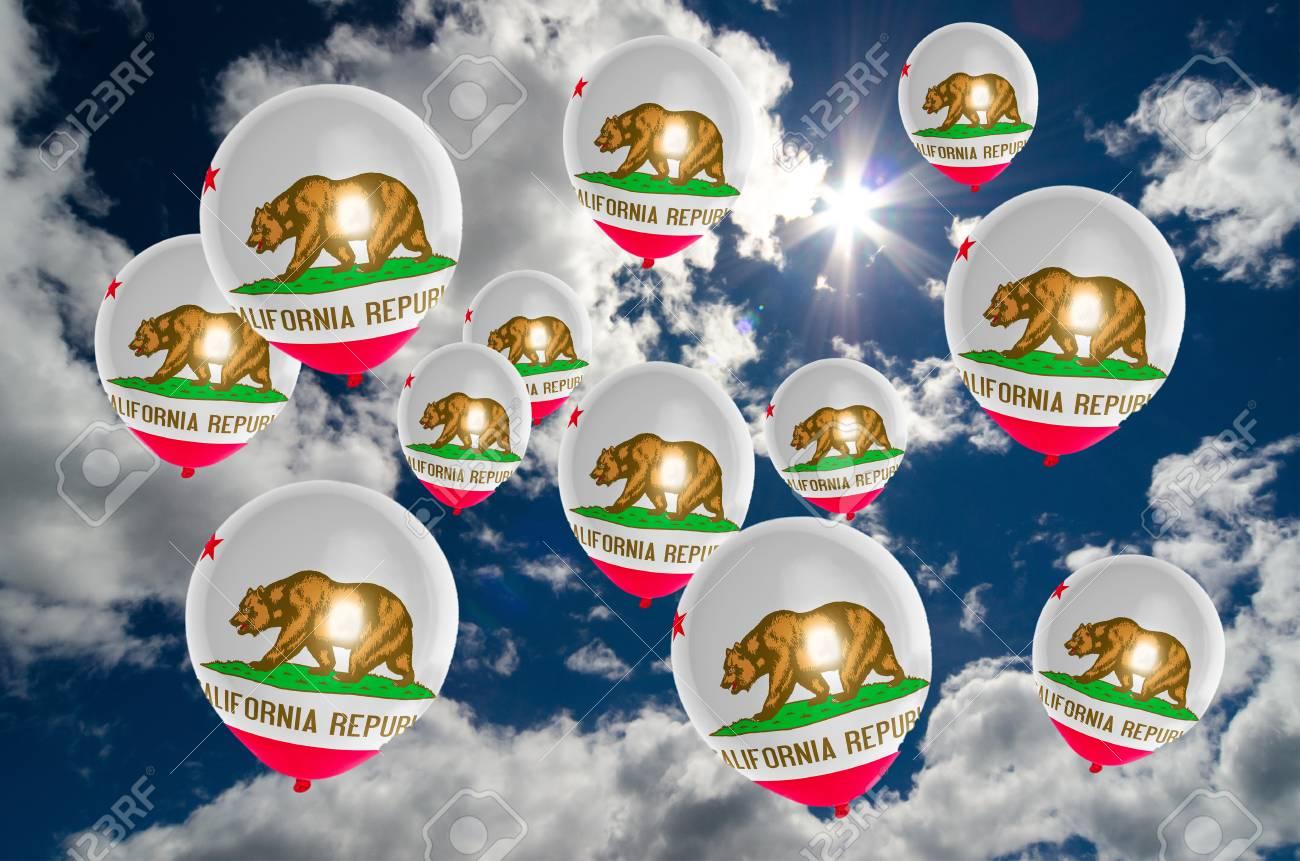 many ballons in colors of california flag flying on sky stock photo