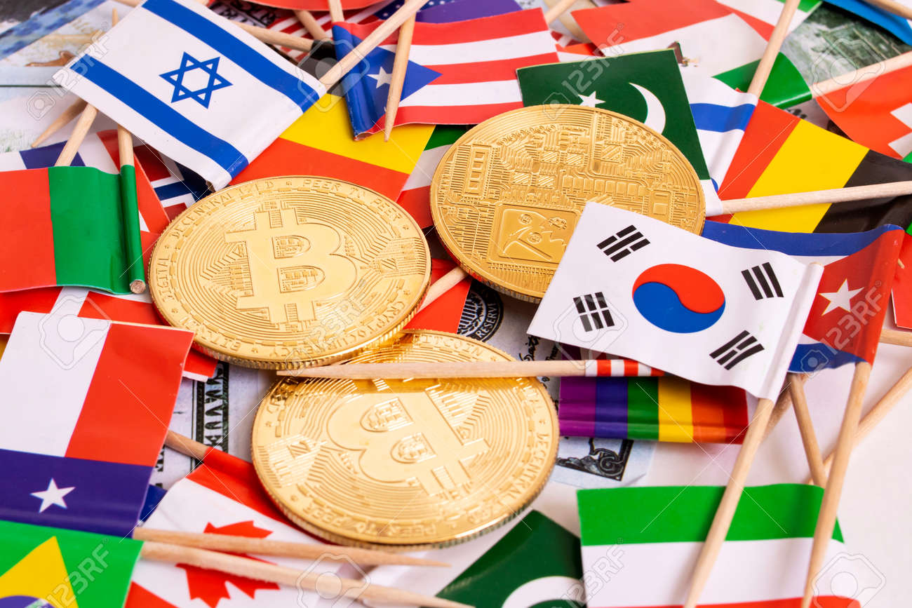 Bitcoins coin on the background of flags of different countries close up - 169322976