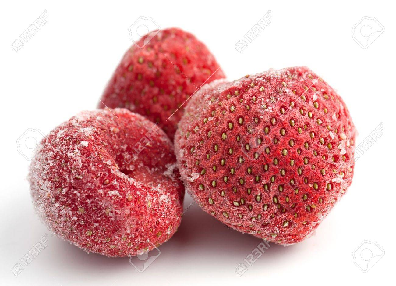 Three frozen strawberries covered in frosted ice on a white background. Stock Photo - 12319980