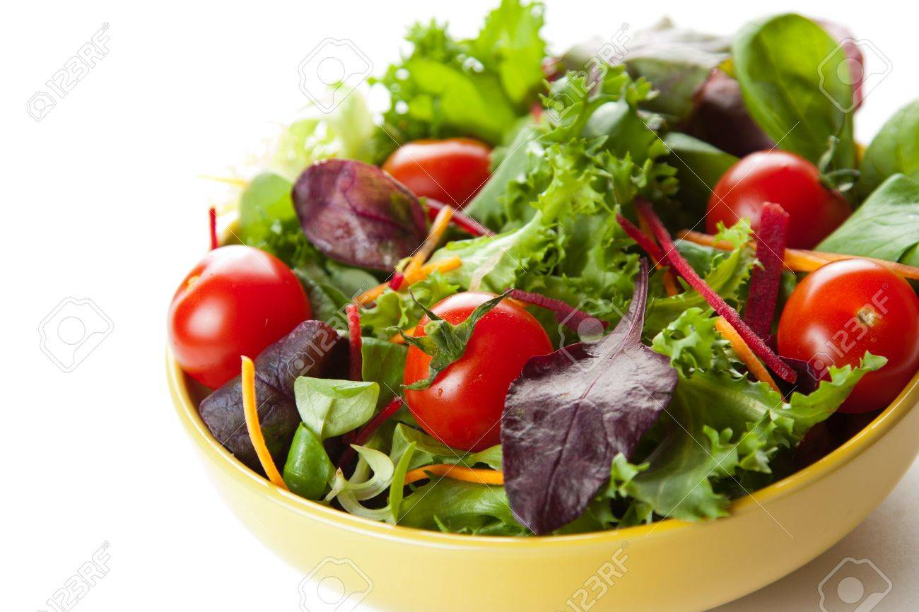 Bowl of fresh crisp green salad with tomatoes and carrots for healthy eating and low calorie dieting Stock Photo - 13646243