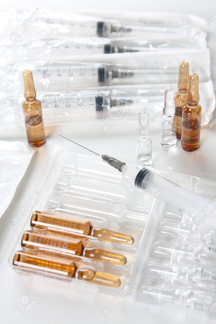 Syringes and ampoules on white surface - medical concept Stock Photo - 13865645