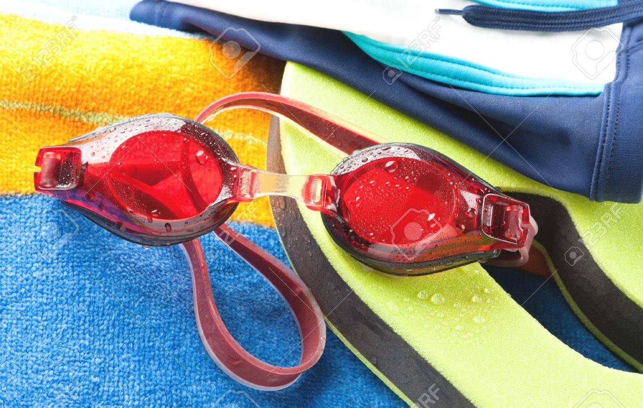 beach goggles  Wet Red Protective Swimming Goggles With A Colourful Beach Towel ...
