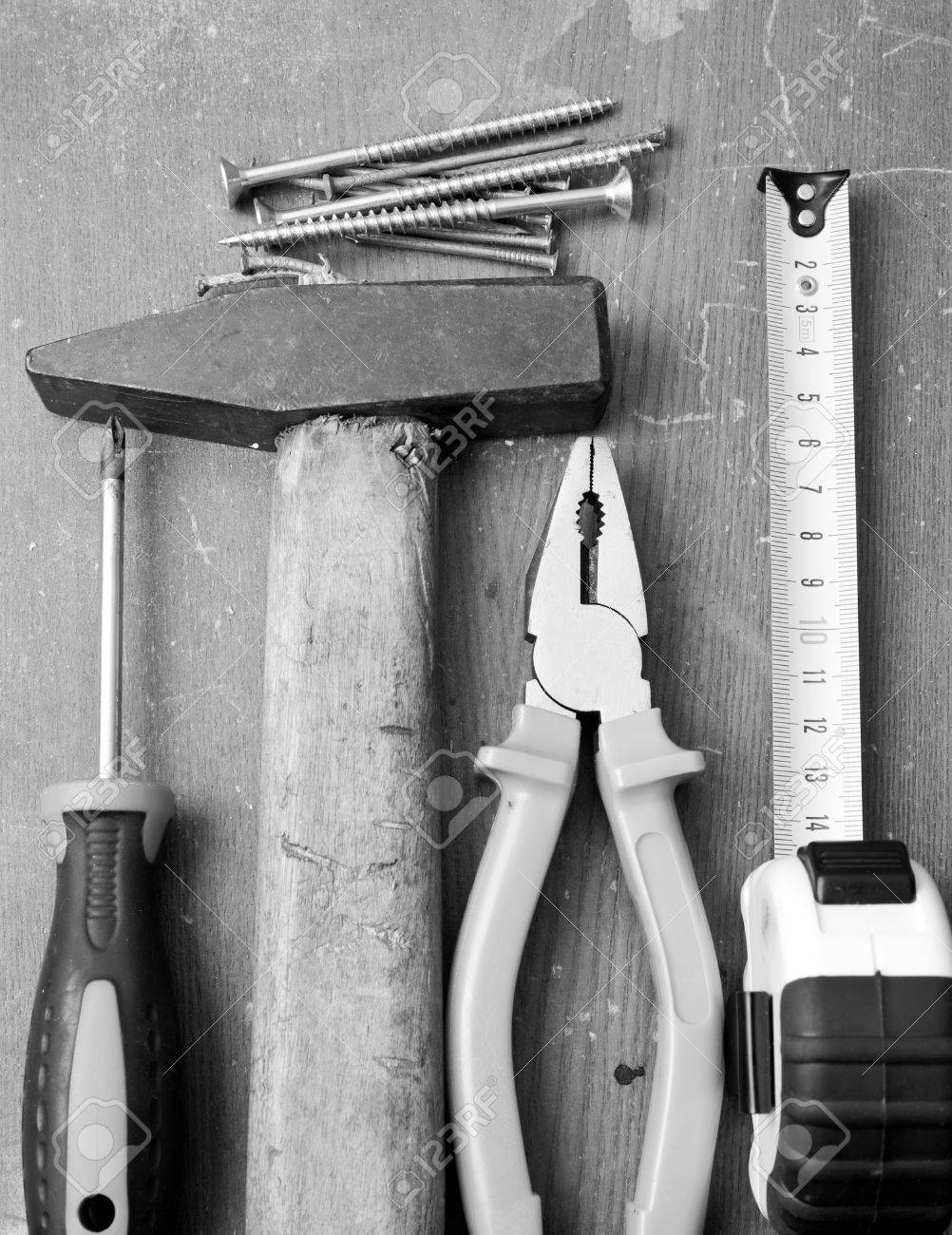 Black and white image of DIY tools and hardware used for home maintenance and repair Stock Photo - 14442529