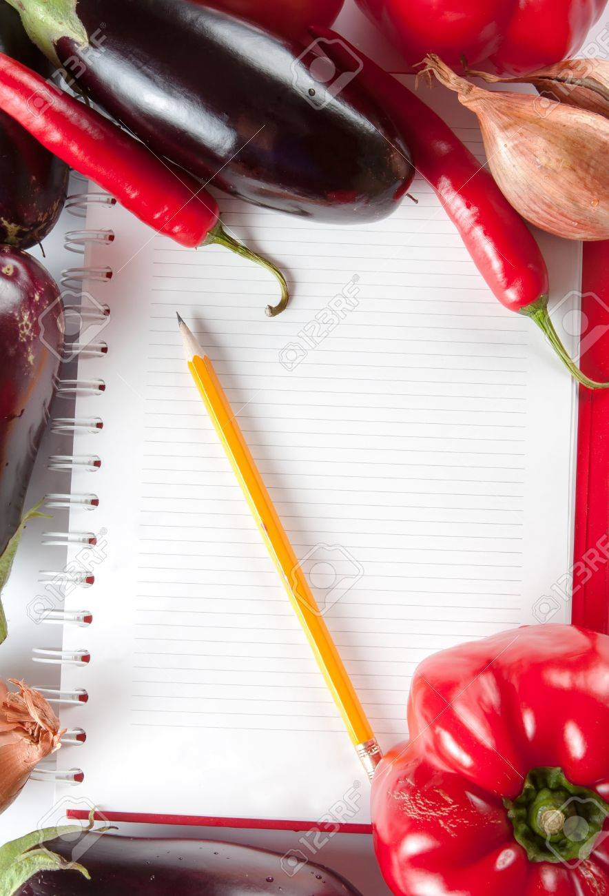 Open blank ringbound notebook surrounded by a variety of fresh vegetables for your shopping or grocery list Stock Photo - 16008293