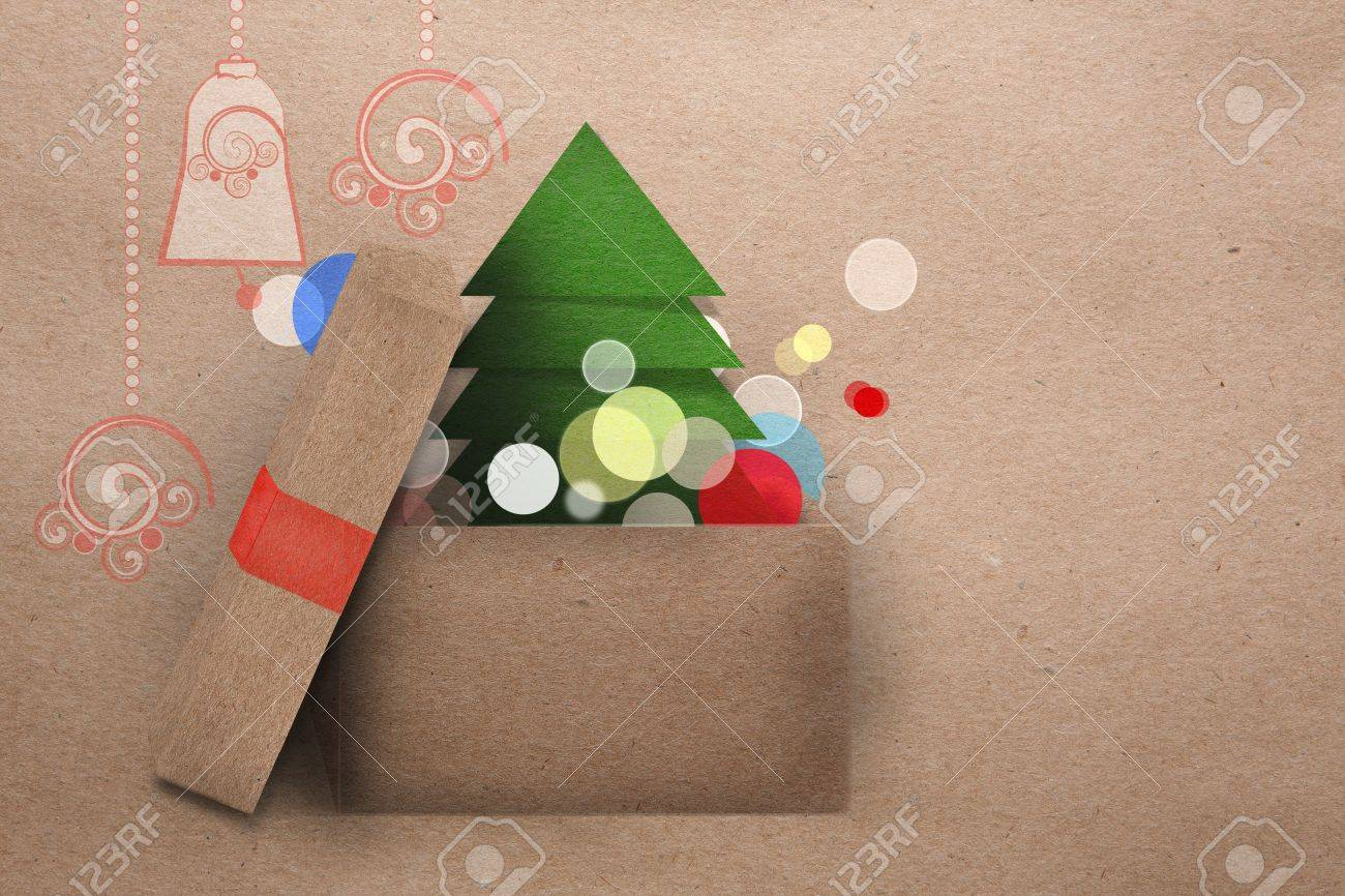 Open Cardboard Box With Colorful Lights And Christmas Tree Getting