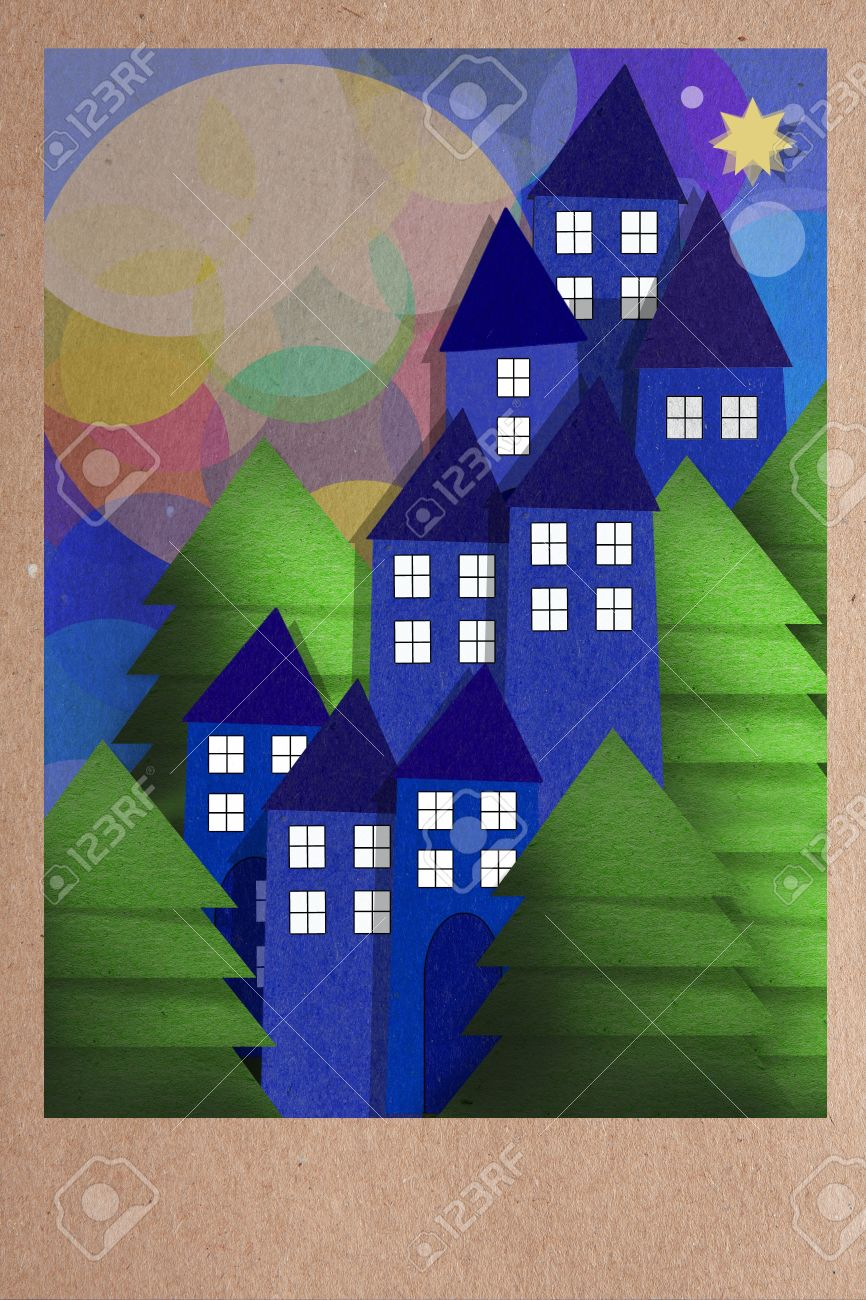 Beautiful paper applique collage of a night view of town houses with illuminated windows nestled amongst