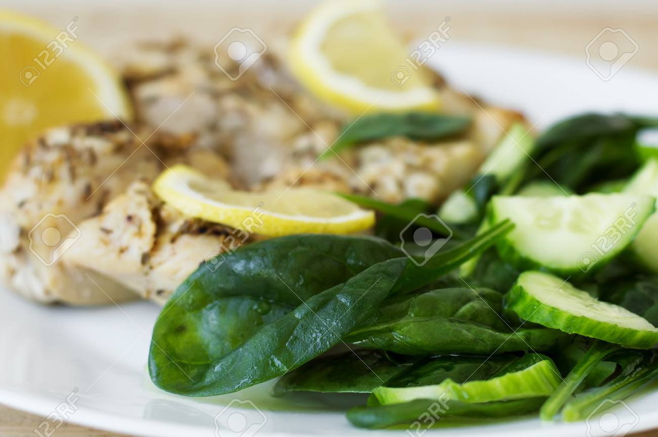 Spinach Salad Served With Baked Chicken Meat And Lemon Slices Stock Photo Picture And Royalty Free Image Image 64470705