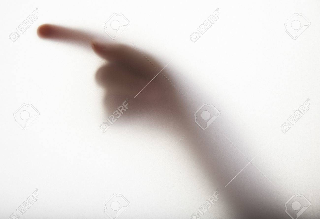 hand silhouette behind a transparent  paper background Stock Photo - 16687978