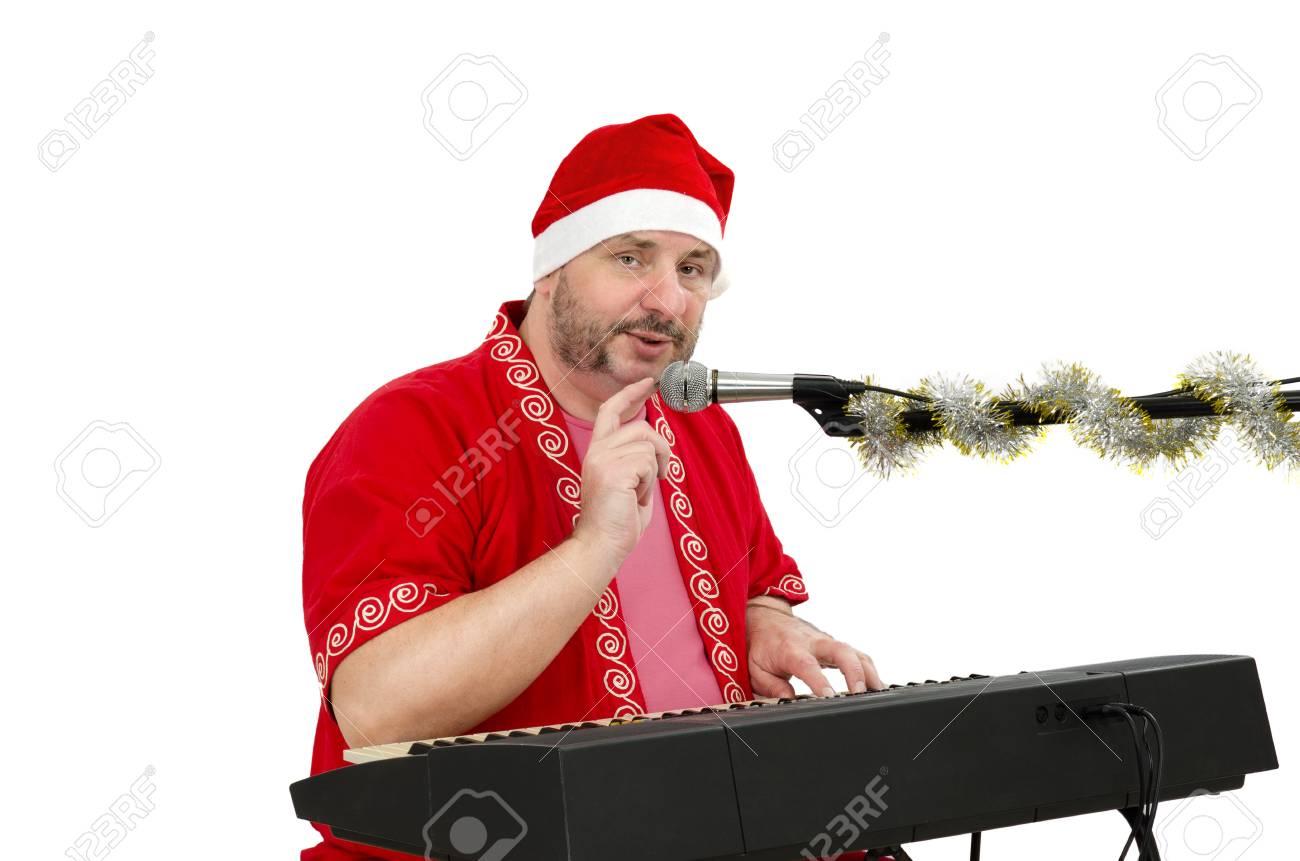 Santa with electric piano Stock Photo - 24480799