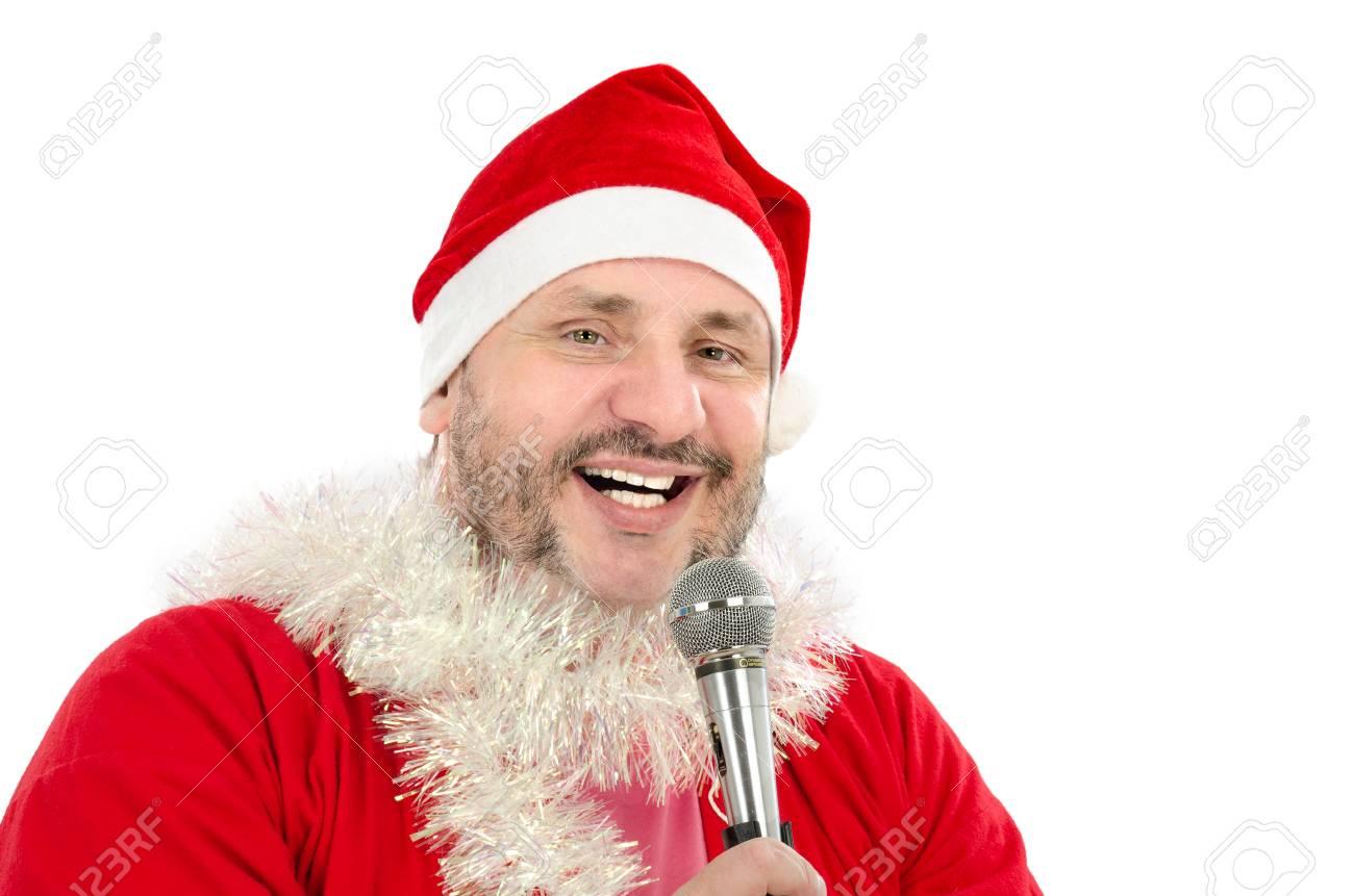 Happy man in Santa Suit Costume singing in microphone Stock Photo - 24480800