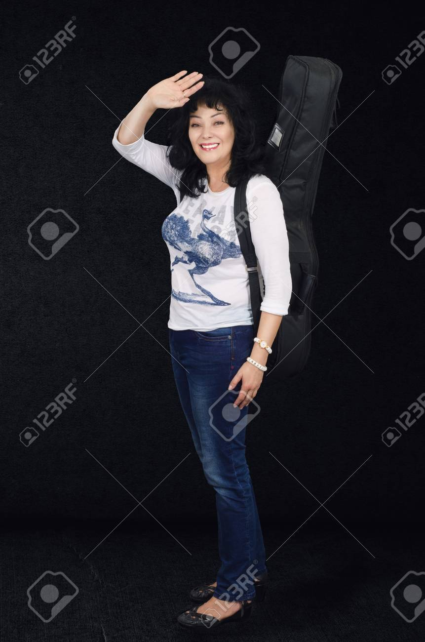 Woman guitarist waving as she went to sound studio Stock Photo - 24731201