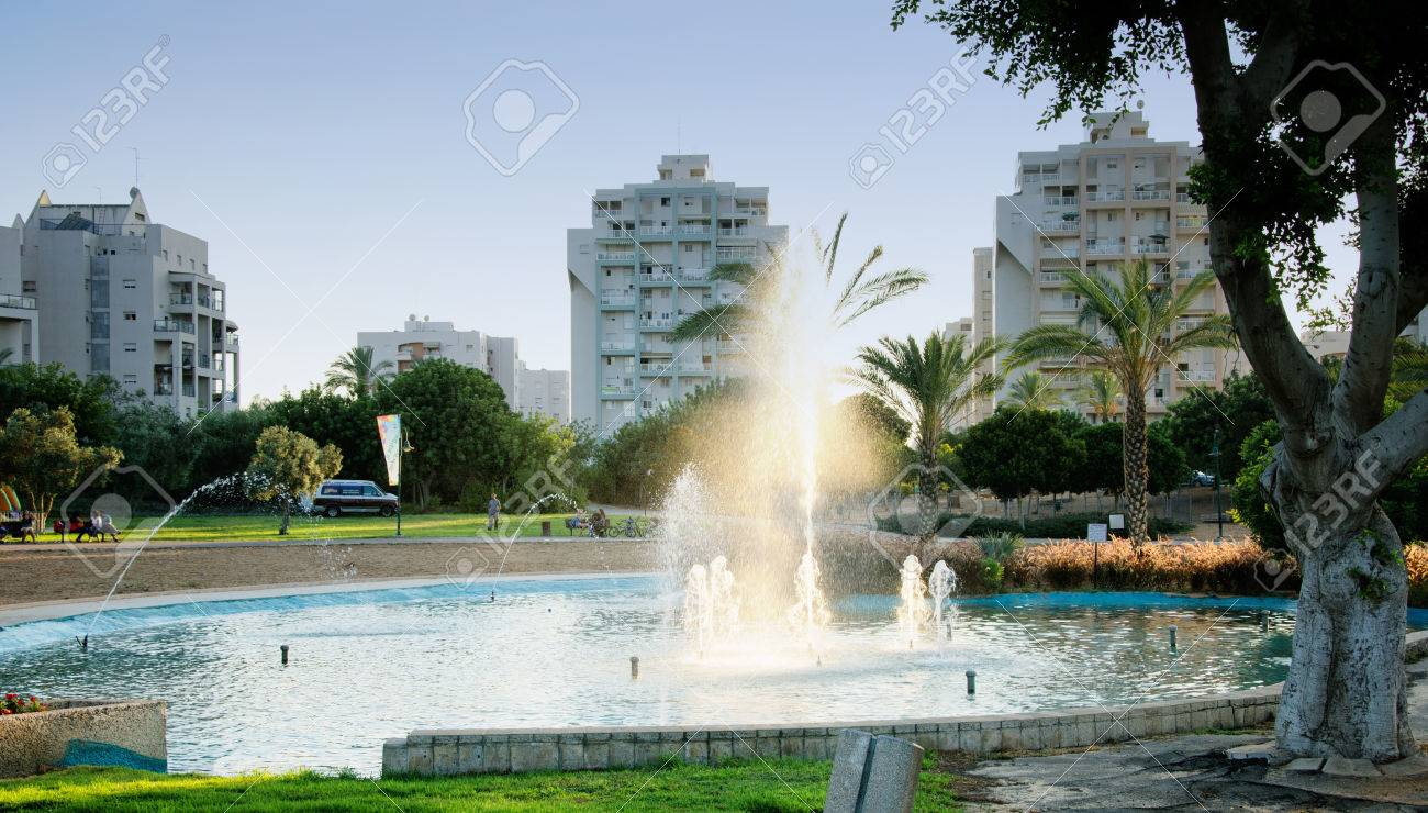 Small Pond With Fountain At Sunset On Apartment Buildings - Small apartment buildings
