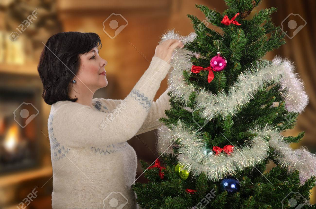Mature Woman Wearing Norwegian Blue And White Sweater Decorating ...