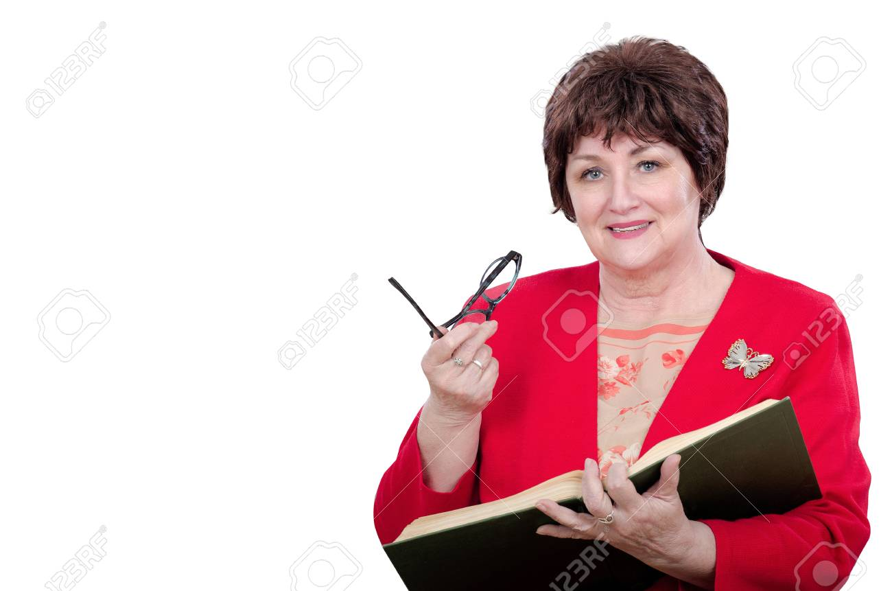 2c597df63cb4 Portrait of cheerful female professor holding big book with left hand and  glasses by right. Adult mature woman wears red jacket with white butterfly  on ...