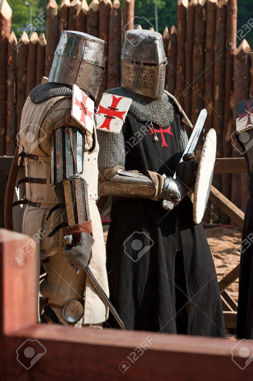 Knight in armour with red crosses Stock Photo - 12659761