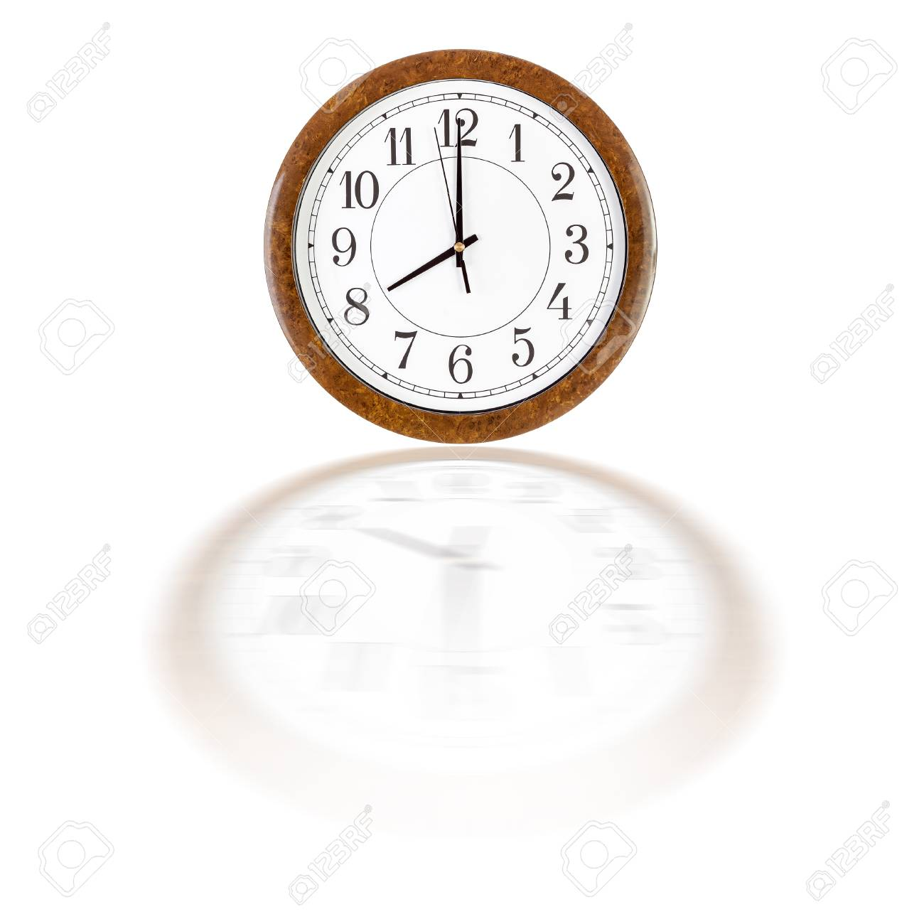 A White Clock Face In Brown Wooden Frame Showing Eight O Stock Photo ...
