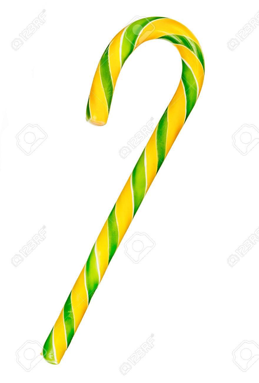 Fest gelb und grün gestreiften Zuckerstange auf weißem Hintergrund isoliert
