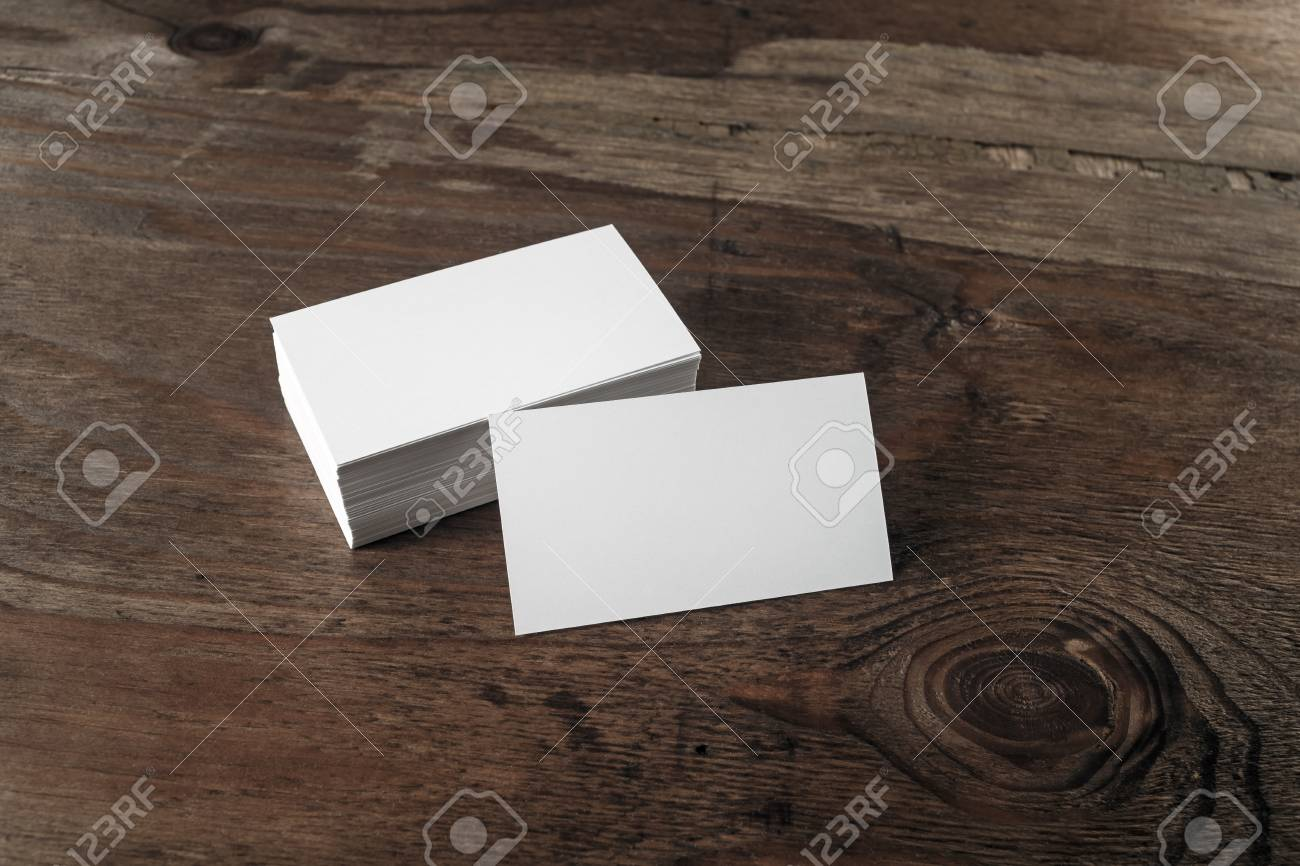 Photo of blank business cards with soft shadows on dark brown photo of blank business cards with soft shadows on dark brown wooden background blank template reheart Image collections