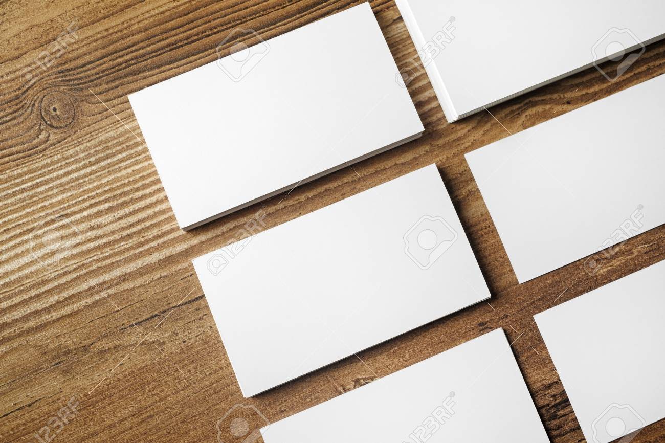 photo of blank business cards on wooden table background blank